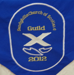 Embroidery on a table cloth for a Church Guild